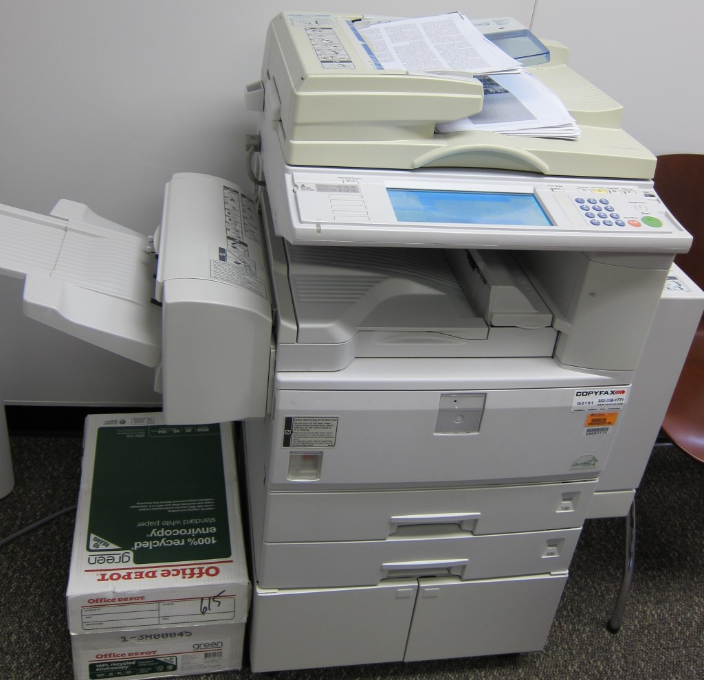 hoto of newer, integrated printer, fax, copier, and scanner: Data Management of Legacy Data
